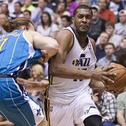 Utah's Derrick Favors drives on New Orleans' Lou Amundson as the Utah Jazz and the New Orleans Hornets play April 5 at Energy Solutions Arena in Salt Lake City. Utah won 95-83.