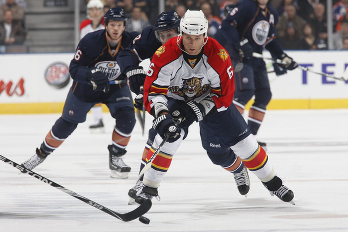 EDMONTON, CANADA - OCTOBER 10:  Dennis Wideman #6 of the Florida Panthers is chased by Ryan Jones #28 of the Edmonton Oilers in first-period action at Rexall Place October 10, 2010 in Edmonton, Alberta, Canada. (Photo by Dale MacMillan/Getty Images)