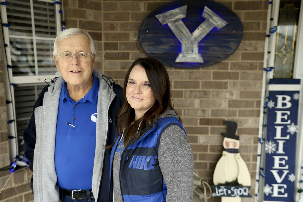 BYU football fans Randy Woodall and his daughter, Kelli Gard, are photographed at the Woodall home in Roy on Friday, Dec. 11, 2020.