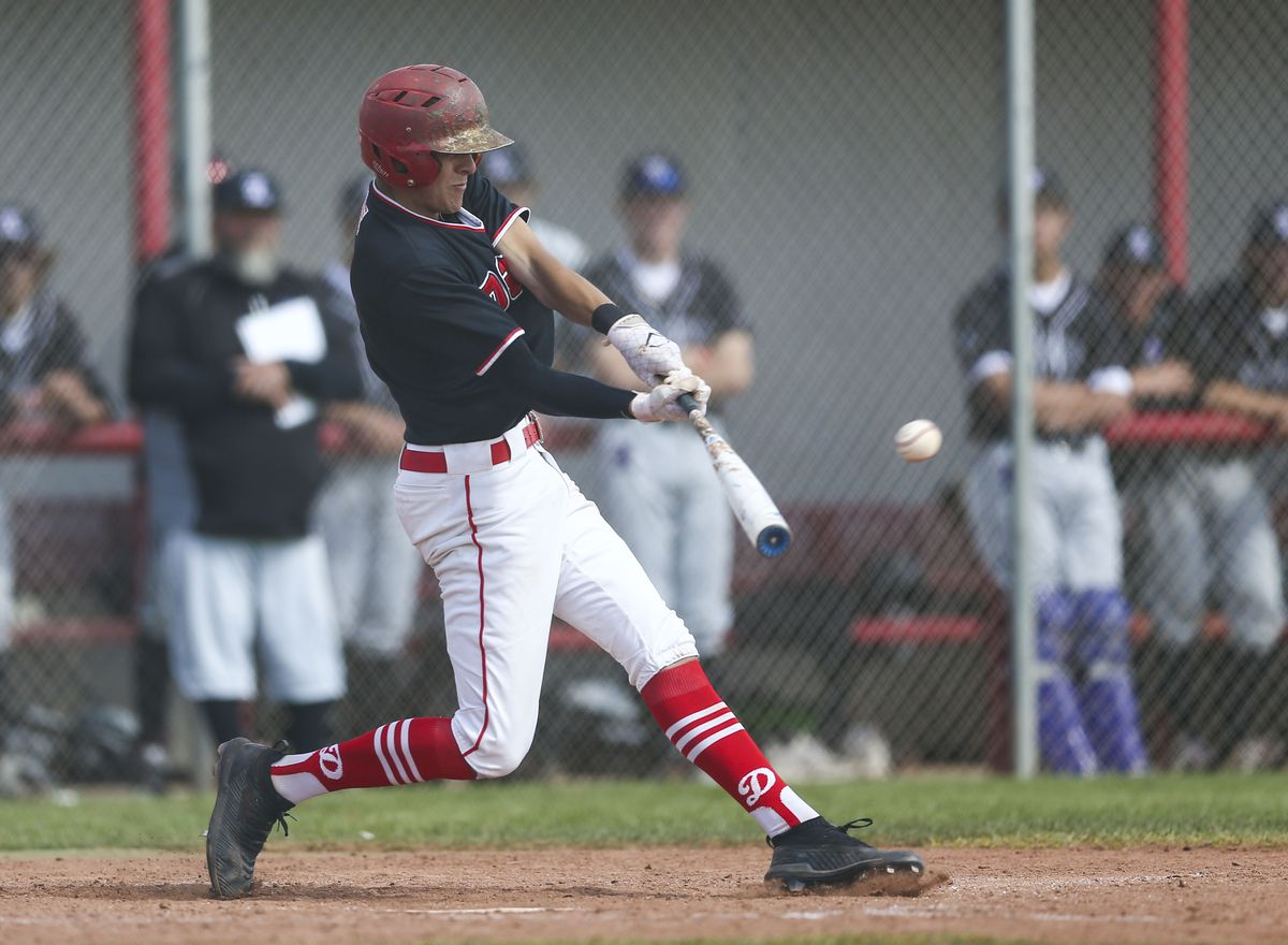 Spanish Fork Dons Andrew Pintar (4) hits the ball against the Lehi Pioneers during their game at Spanish Fork High School in Spanish Fork on Thursday, May 2, 2019.