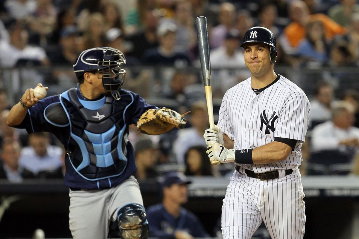 Mark Teixeira of the New York Yankees strikes out in the third inning Thursday night against the Tampa Bay Rays.  (Photo by Jim McIsaac/Getty Images)