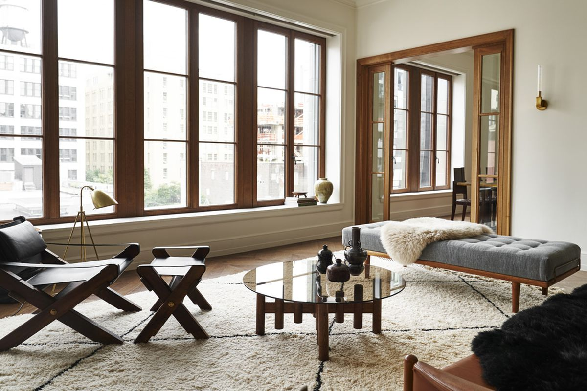 The living rooms feature oversized oak casement windows that look onto West 24t Street.