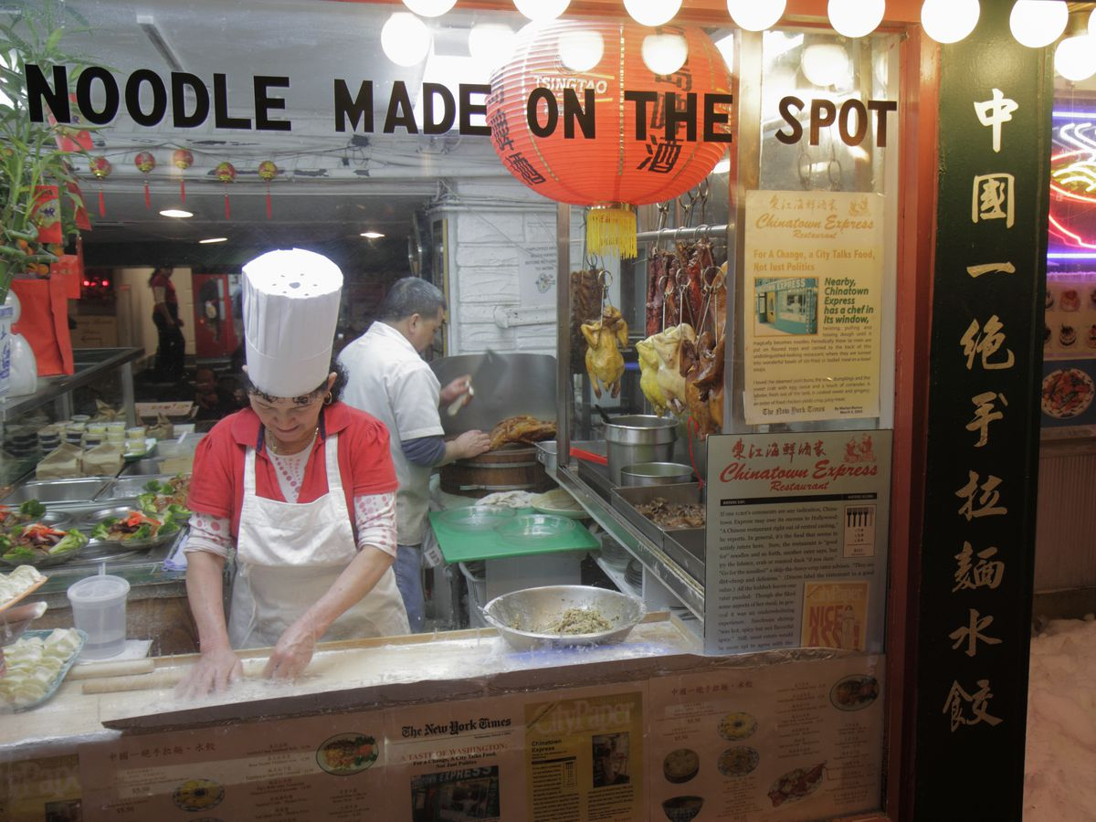 A noodle maker in the window at Chinatown express