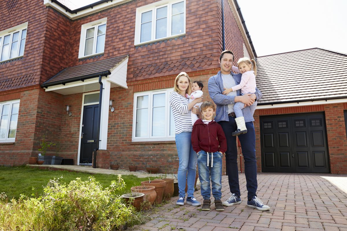 Family outside new home