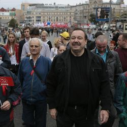 Russian opposition activist Gennady Gudkov, center, walks with opposition supporters to take part in a protest rally in Moscow, Saturday, Sept. 15, 2012. Thousands of protesters marched across downtown Moscow on Saturday in the first major rally in three months against President Vladimir Putin, while defying the Kremlin's ongoing efforts to crackdown on opposition. Gennady Gudkov was stripped of his  was stripped of his parliament seat by the Kremlin-controlled parliament on Friday.
