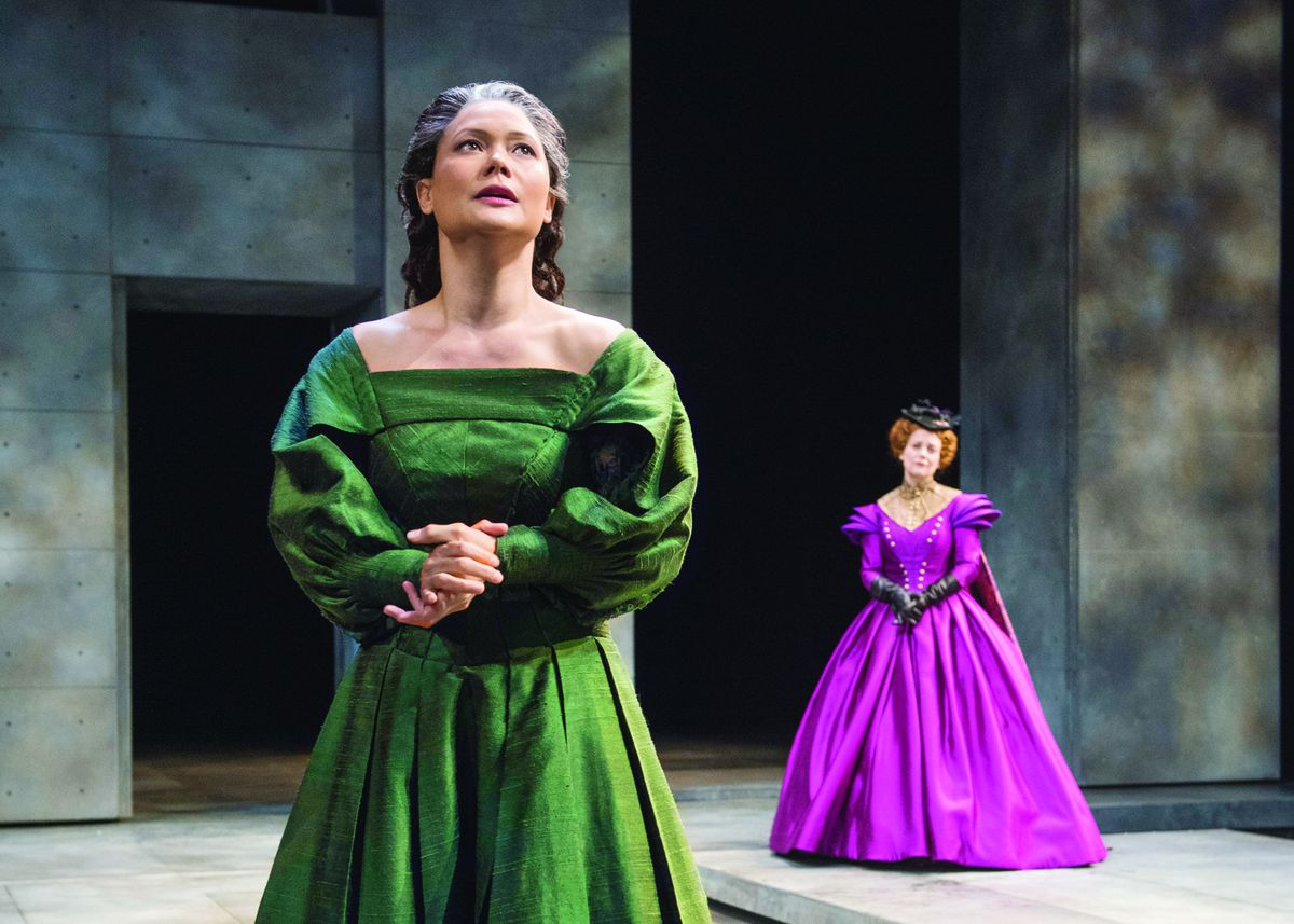 """Mary Stuart (K.K. Moggie, foreground) implores her cousin Queen Elizabeth I (Kellie Overbey) to release her from her imprisonment in Chicago Shakespeare Theater's production of """"Mary Stuart,"""" directed by Jenn Thompson at CST's Courtyard Theater. 
