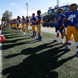 Cyprus players line up for the national anthem before a high school football game against Snow Canyon at Cyprus High School in Magna on Friday, Aug. 14, 2020.