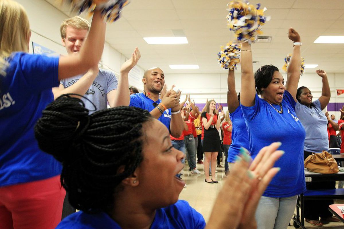 Georgian Hills Achievement Elementary staff celebrate test score results in 2015. The state-run school is now one of four to exit the state's priority list.