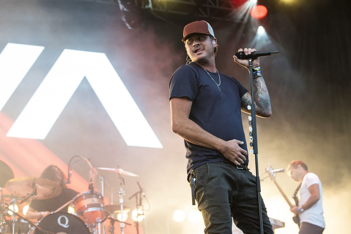 Tom DeLonge, of Angels & Airwaves, performs Saturday evening on day three of Lollapalooza in Grant Park.