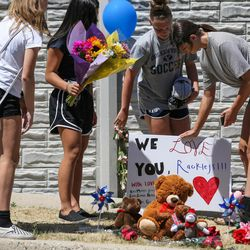 Kate Munger, Jessey Fournier, Sophie Fry and Sydney Schmidt, all 14, place flowers, stuffed animals and a sign at a memorial to the victims of Tuesday\'s fatal shooting on Alta Canyon Drive in Sandy on Wednesday, June 7, 2017.