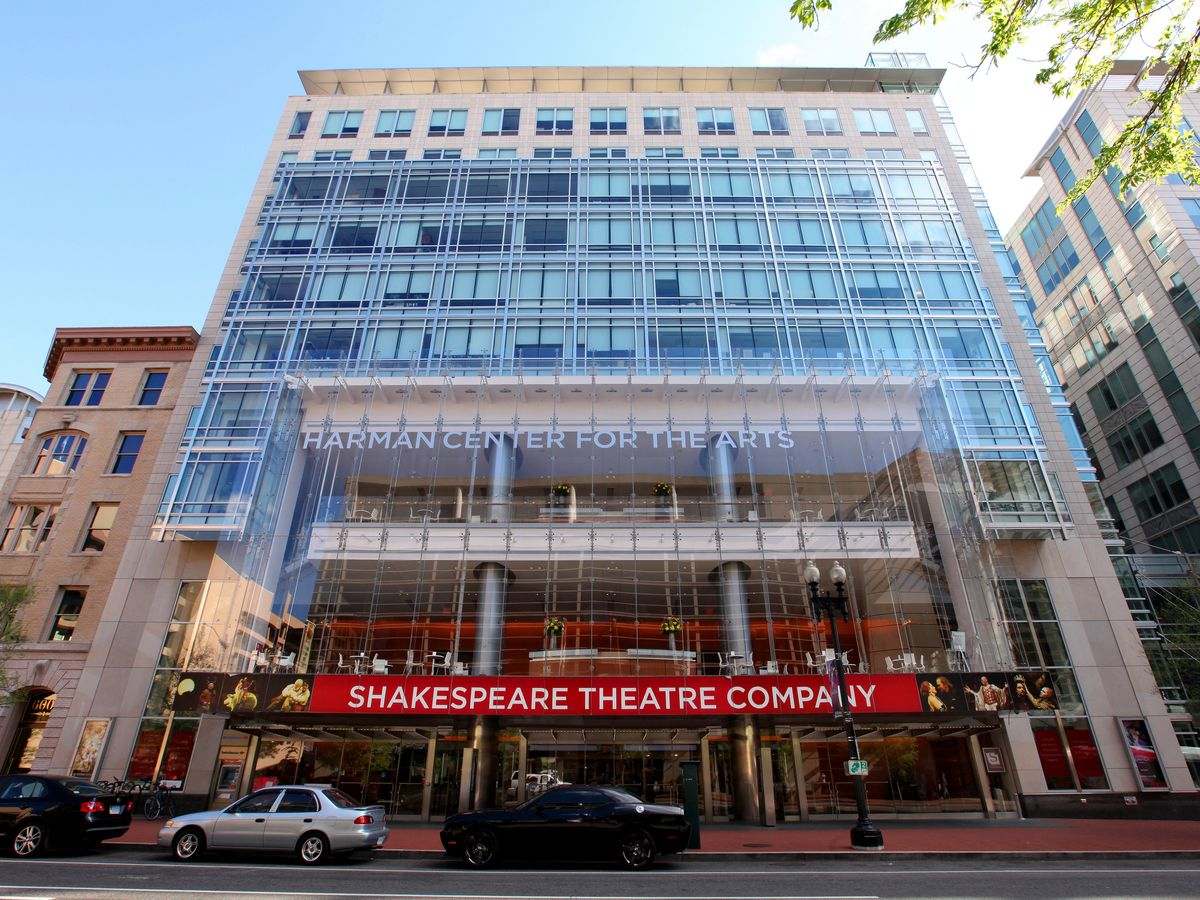 The exterior of the Shakespeare Theatre Company in Washington D.C. The facade is glass with many windows.