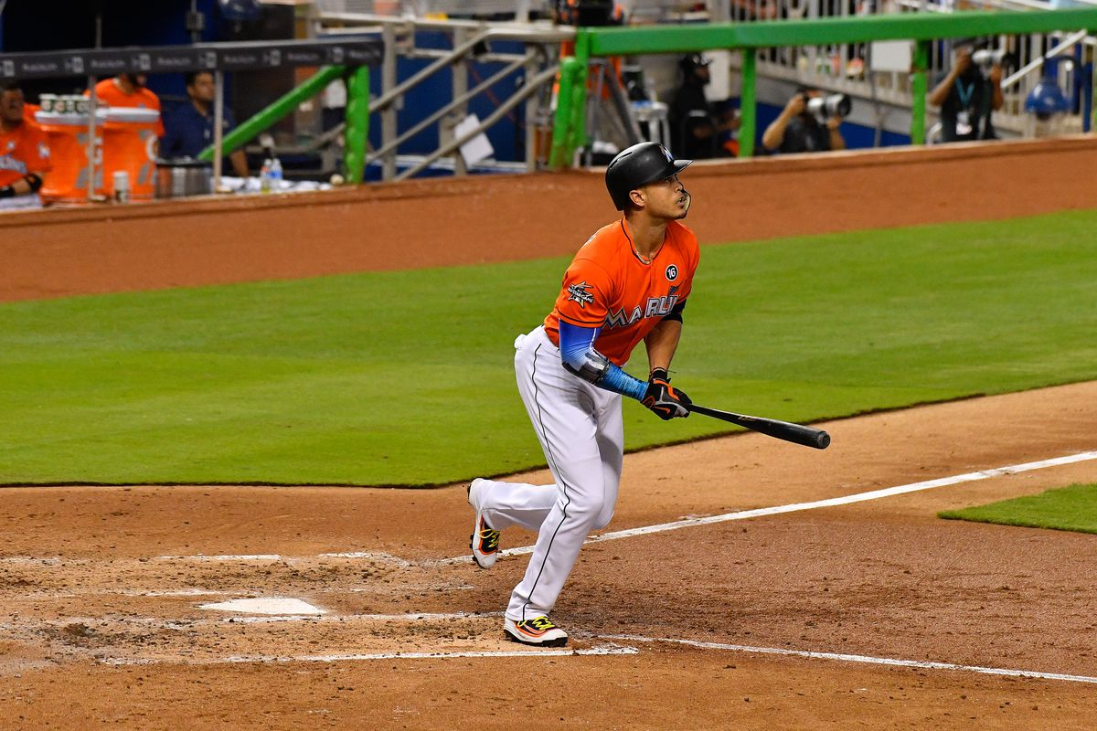 After breaking Marlins' season home run record, Stanton gets beer shower