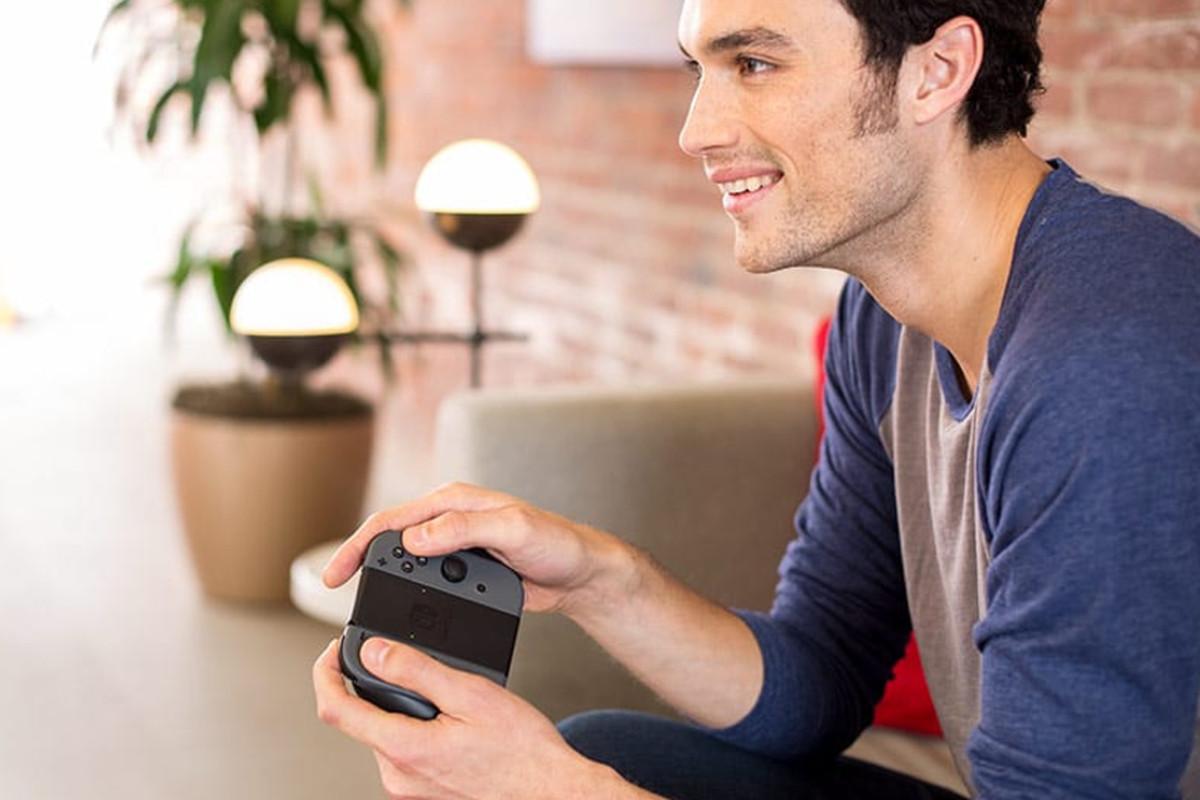 man playing nintendo switch online