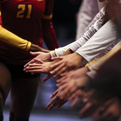 Teammates high five as the starting lineup for Mountain View is announced before the 5A high school state finals match at the UCCU Center on the Utah Valley University campus in Orem on Saturday, Nov. 9, 2019.