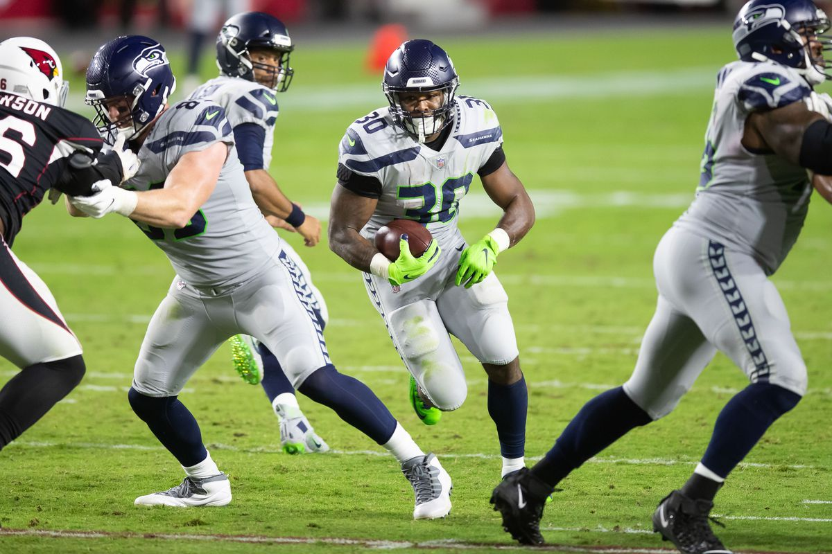 Seattle Seahawks running back Carlos Hyde runs against the Arizona Cardinals in the fourth quarter at State Farm Stadium.