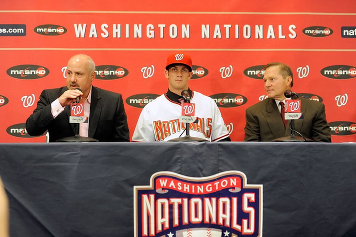 WASHINGTON - AUGUST 26:  General Manger Mike Rizzo Bryce Harper #34 of the Washington Nationals and Scott Boras talk to the media during a press conference at Nationals Park on August 26 2010 in Washington DC.  (Photo by Greg Fiume/Getty Images)