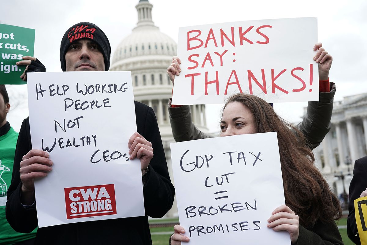 Activists Call For Repeal Of Tax Cuts Legislation At Tax March On Capitol Hill