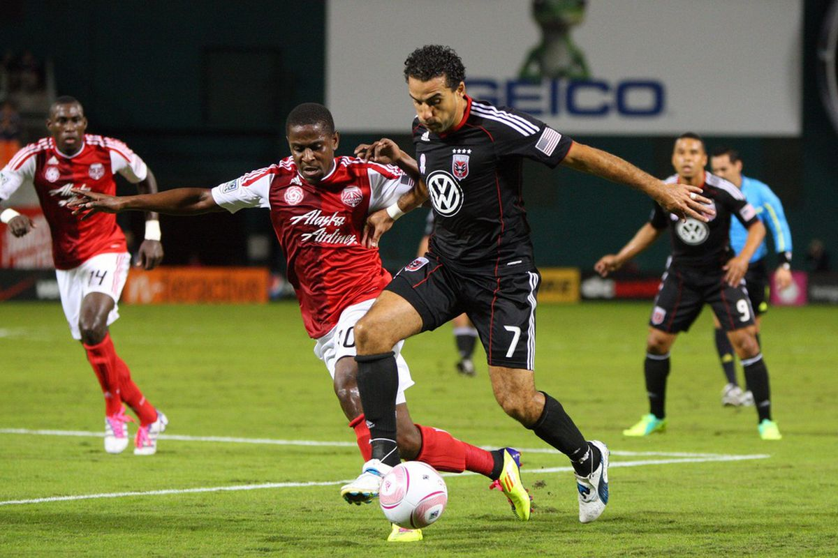 WASHINGTON, DC - OCTOBER 19: Dwayne De Rosario #7 of D.C. United controls the ball against Lovel Palmer #30 of the Portland Timbers at RFK Stadium on October 19, 2011 in Washington, DC. (Photo by Ned Dishman/Getty Images)