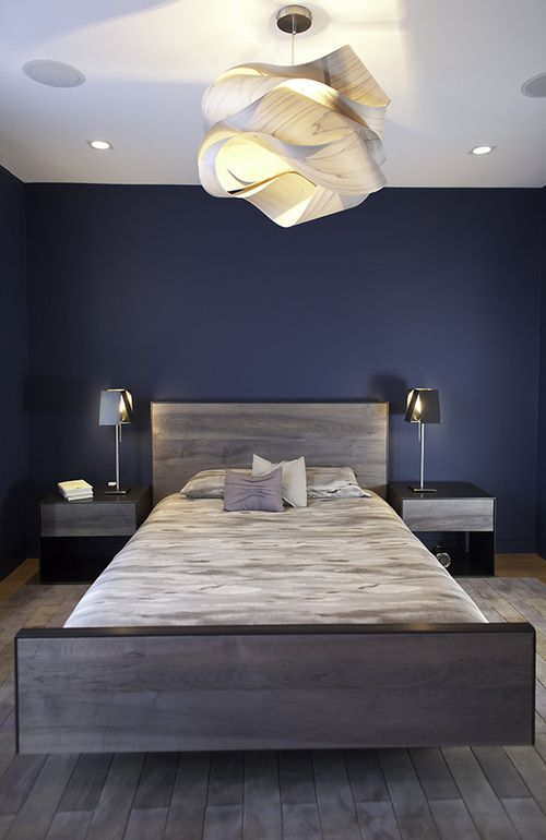 A Dark Blue Wall In Master Bedroom