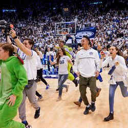Brigham Young Cougars fans rush the court after BYU toppled No. 2-ranked Gonzaga 91-78 at the Marriott Center in Provo on Saturday, Feb. 22, 2020.