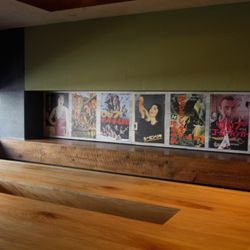 Upstairs, a 16-seat communal table, surrounded by Japanese movie prints on the walls.