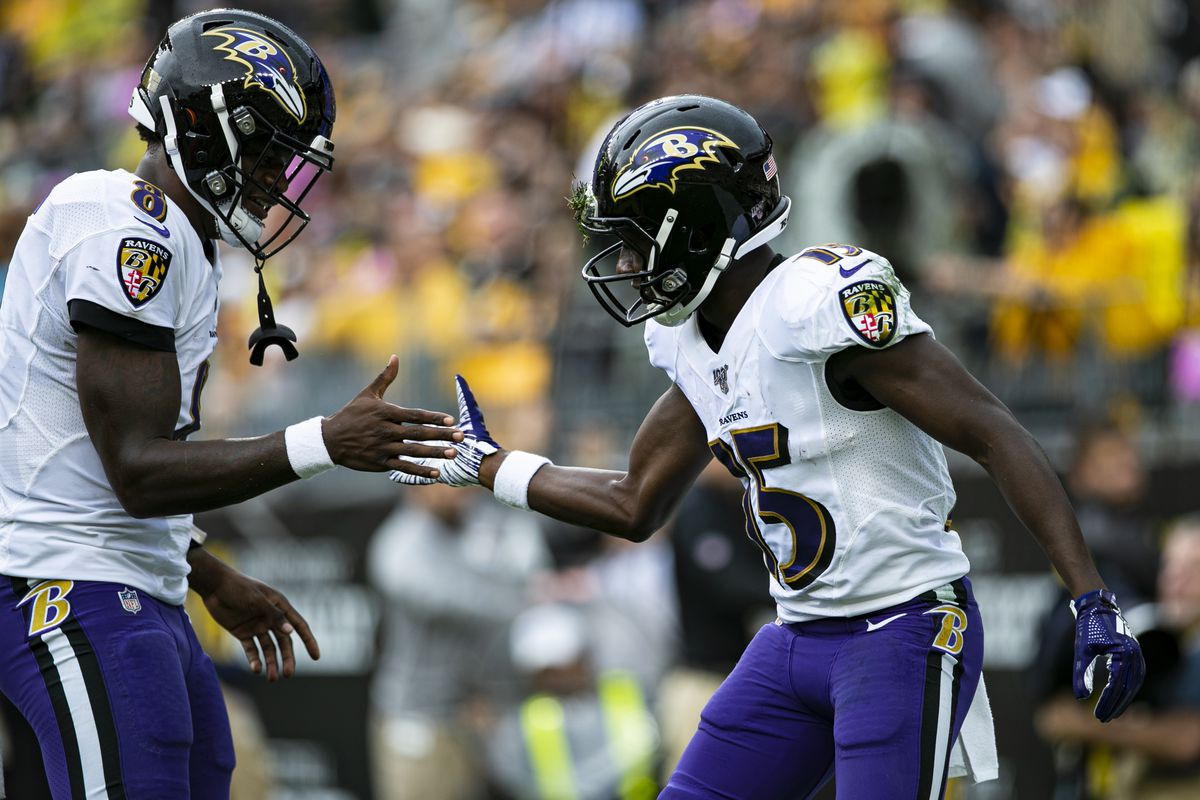 Baltimore Ravens wide receiver Marquise Brown celebrates with Baltimore Ravens quarterback Lamar Jackson after a touchdown during the NFL football game between the Baltimore Ravens and the Pittsburgh Steelers at Heinz Field in Pittsburgh, PA.
