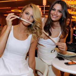Sports Illustrated Swimsuit models Kate Bock and Alyssa Miller at Andrea's. David Becker/WireImage