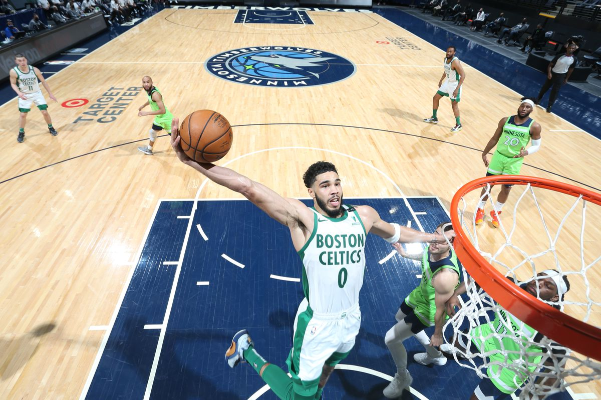 Jayson Tatum #0 of the Boston Celtics dunks the ball during the game against the Minnesota Timberwolves on May 15, 2021 at Target Center in Minneapolis, Minnesota. NOTE TO USER: User expressly acknowledges and agree