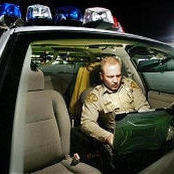 Dirk Roesler checks his computer for any messages as he patrols in the Herriman area on Thursday.