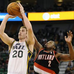 Utah Jazz small forward Gordon Hayward (20) is fouled from behind by Portland Trail Blazers shooting guard Wesley Matthews (2) in the second half of a game at the Energy Solutions Arena on Wednesday, October 16, 2013.