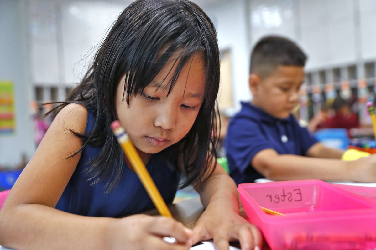 """Ester Zing works on the letter """"F"""" in her class, at Jeremiah Gray Kindergarten Academy, Friday, August 2, 2019."""
