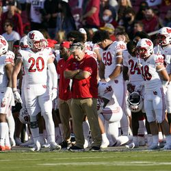 Utah players and coaches observe a moment of silence in honor of slain teammate Aaron Lowe before an NCAA college football game against Southern California on Saturday, Oct. 9, 2021, in Los Angeles.