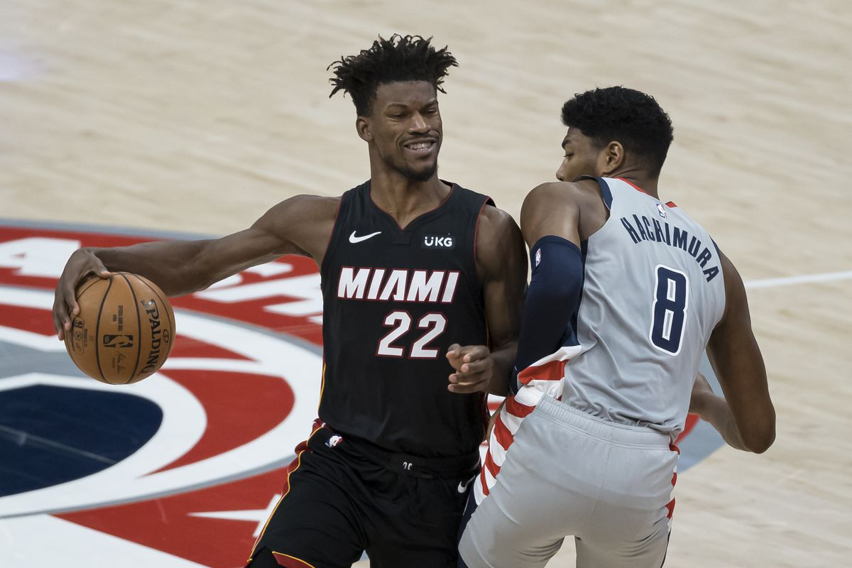 Jimmy Butler of the Miami Heat battles for position against Rui Hachimura of the Washington Wizards during the first half at Capital One Arena on January 9, 2021 in Washington, DC.