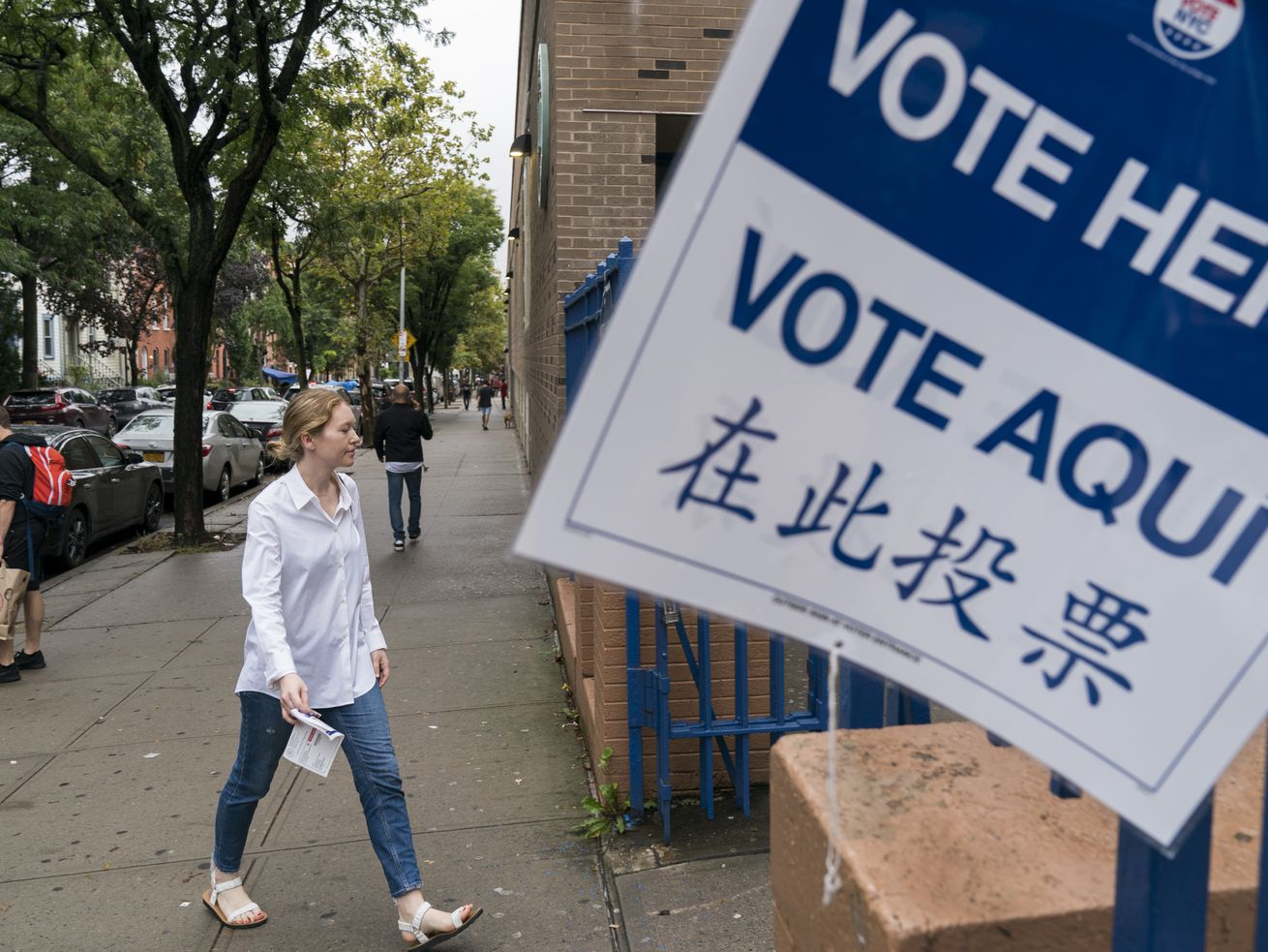 A woman arrives at a polling station on New York state's primary election day in September 2018.