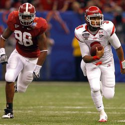 Utah quarterback Brian Johnson (3) runs for a first down with Alabama linebacker Brandon Fanney (98)   during the first half of the 2009 Allstate Sugar Bowl, at the Superdome, in New Orleans, LA. Friday Jan. 2, 2009. Photo by Scott G. Winterton/Deseret News