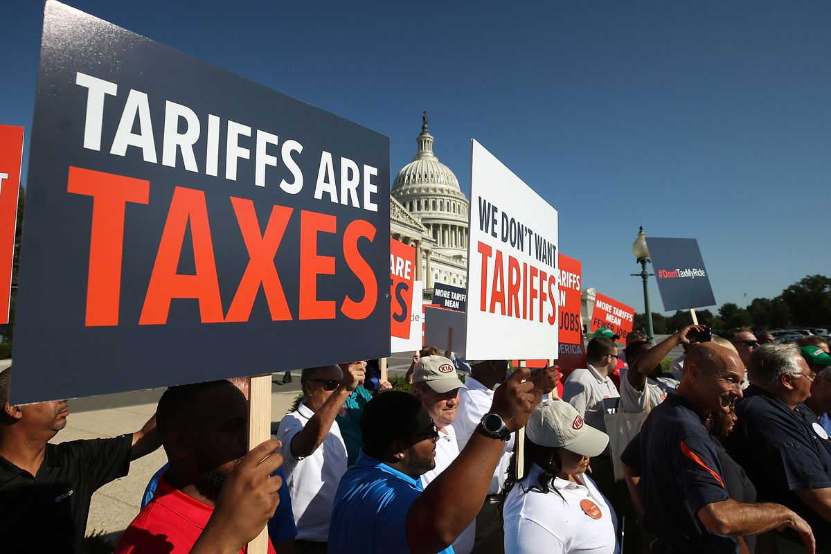 Auto workers rally against President Donald Trump's proposed tariffs on auto imports and the impact on auto makers and their surrounding communities on Capitol Hill on July 19, 2018.