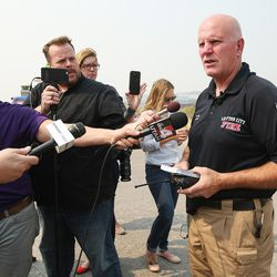 Layton City Fire Marshal Doug Bitton gives a media briefing as officials continue to fight a wild fire during near Weber Canyon on Tuesday, Sept. 5, 2017.