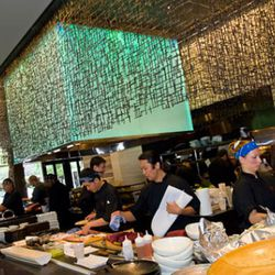 Sushi and robata chefs plug away in an open setting