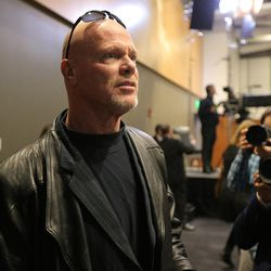 Jim McMahon enters the hall as family, friends and former team members gather to honor former BYU football coach LaVell Edwards at a memorial service at the Provo Convention Center on Friday, Jan. 6, 2017.