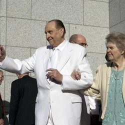 President Thomas S. Monson waves to the crowd as he and his wife Sister Frances Monson leave the cornerstone ceremony for the Draper Temple Friday, March 20, 2009.