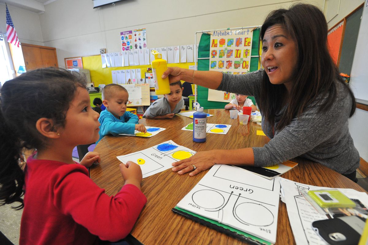 Pre-school teacher Aimee Iwasaki works with her mild to moderately disabled students including Aimee Hernandez, left, on a painting and colors exercise at Buffum Total Learning Center in Long Beach, CA on Wednesday, October 9, 2013. (Photo by Scott Varley/Digital First Media/Torrance Daily Breeze via Getty Images)
