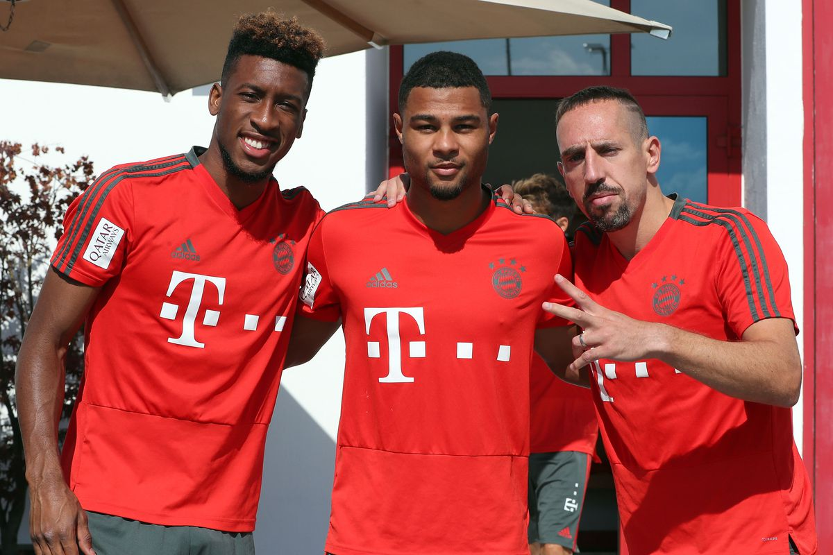 FC Bayern Muenchen - Training Session MUNICH, GERMANY - JULY 12: Kingsley Coman, Serge Gnabry and Franck Ribery (L-R) of FC Bayern Muenchen pose before a training session at the club's Saebener Strasse training ground on July 12, 2018 in Munich, Germany.