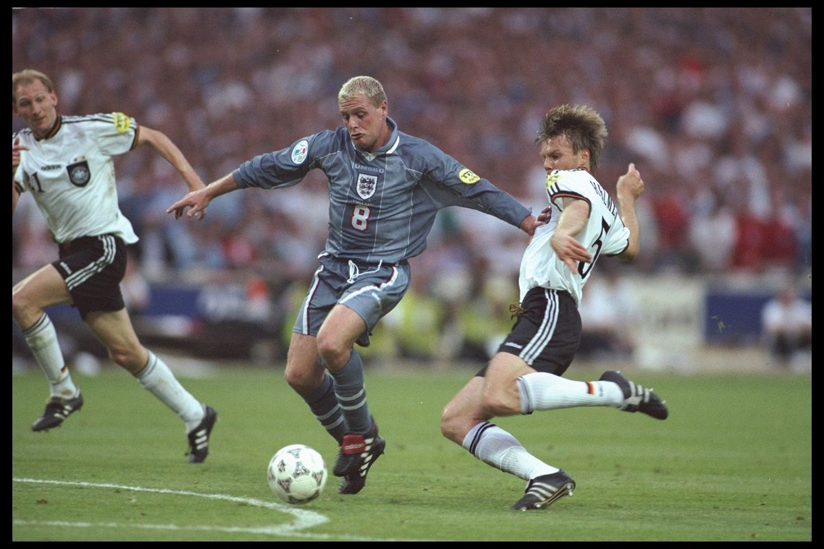 Paul Gascoigne of England (number 8) is challenged by Thomas Helmer of Germany