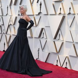 Lady Gaga arrives for the Academy Awards in an Alexander McQueen gown. | MARK RALSTON/AFP/Getty Images