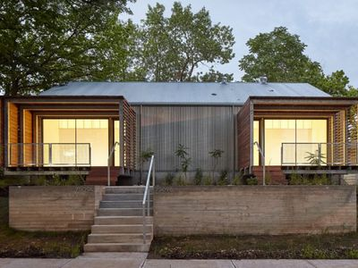 Architecture students build modern duplex for low-income families