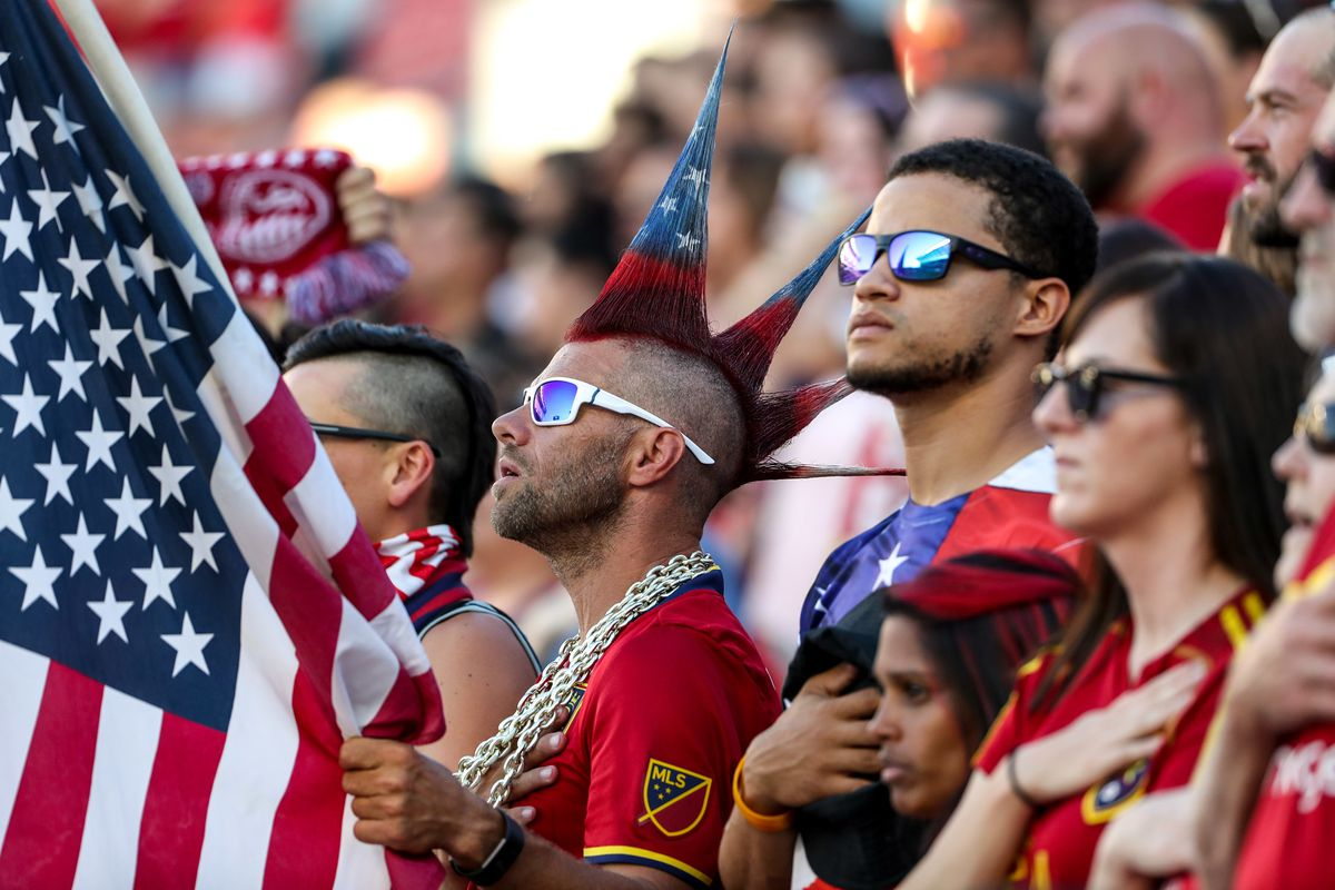 Real Salt Lake fans pt their hands on their hearts during the National Anthem before the Real Salt Lake versus Sporting KC at Rio Tinto Stadium in Sandy on Wednesday, July 4, 2018.