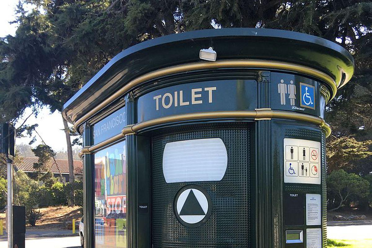 A green toilet kiosk in SF.