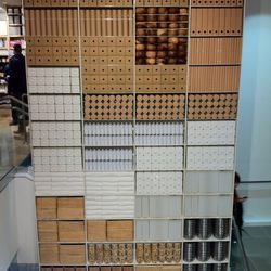 This wall partition spans two stories and is made entirely of MUJI products