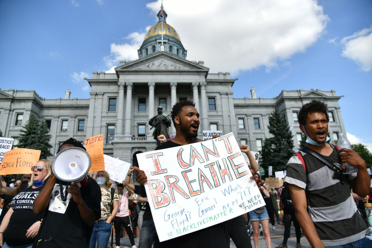 Demonstrators protest the death of George Floyd at the hands of Minneapolis police officers at the Colorado State Capitol in Denver.