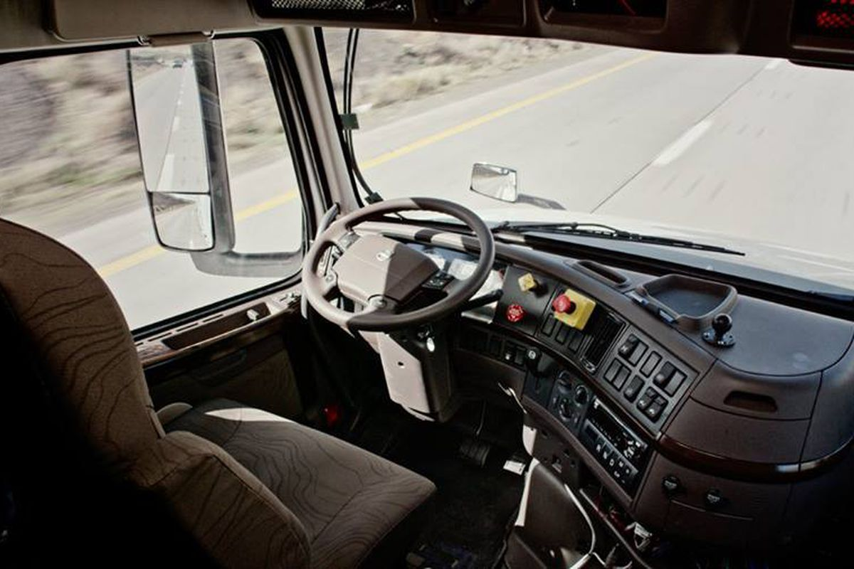 The cab interior of a self-driving truck as it drives on  a highway